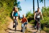 family riding bikes on a bike path
