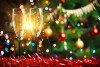two champagne flutes in holiday scene with sparklers