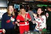 3 pretty women wearing Christmas sweaters at a party