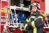 a fireman stands near a firetruck