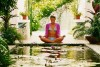 girl meditating by pond